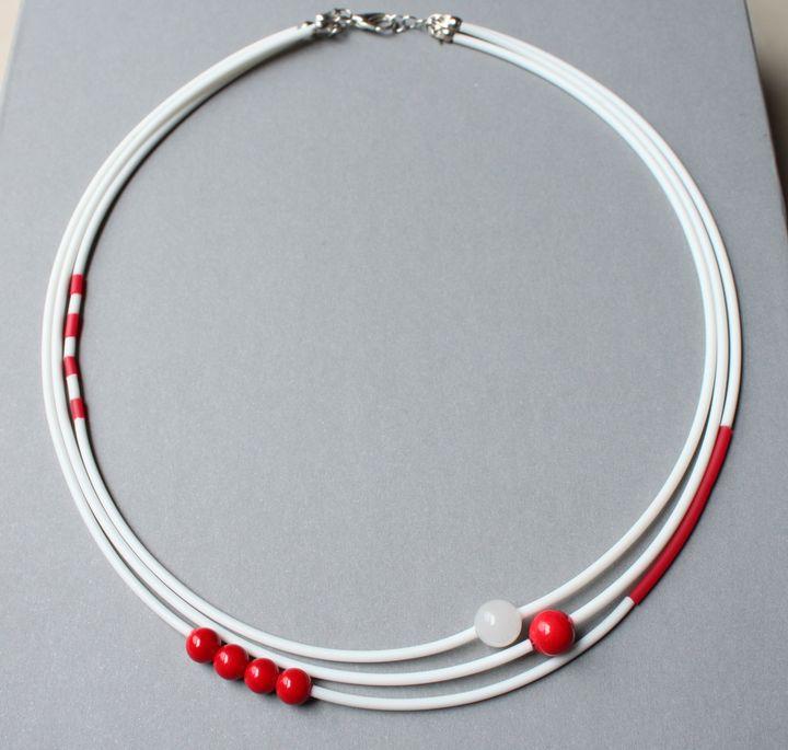 collier caoutchouc perles, rouge et blanc
